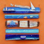 croazia, isola di lussino, cartello indicante escrusioni in barca al porticciolo di lussino grande