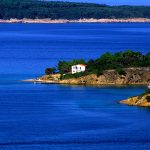 Croatia, Island of Rab, a house by the sea in a cove along the coast of lal