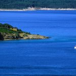 Croazia, Island of Rab, a sailboat is the bay in one of the many inlets of the island