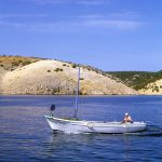 Croatia, Island of Rab, a fisherman with his boat in Lopar