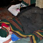eurasia, georgia, una donna anziana profuga, molto malata nella sua abitazione nella periferia di tblisi |Eurasia, Georgia, an elderly woman refugee, very ill at his home on the outskirts of Tbilisi