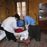 eurasia, georgia, una donna anziana molto malata nella sua abitazione nella periferia di tblisi, viene curata dal personale medico della caritas |Eurasia, Georgia, an elderly woman very ill at his home on the outskirts of Tbilisi, is treated by the medical staff of caritas