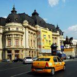 Europa,Romania, una via del centrocon un poalazzo antico adibito a Banca