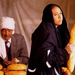 Tunisia, women with baguettes in the medina of Tozeur