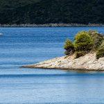 a boat sailing along the coast of Croatia in zverinak