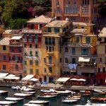 portofino the long sea with the pastel colored houses in Portofino