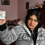 Europe, Romania, Iasi, a woman of Rom origin, exhibiting his identity card 'inside his home