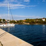 the entrance to the port on the island of molat in Croatia