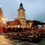 a Christmas tree in the center of Brasov